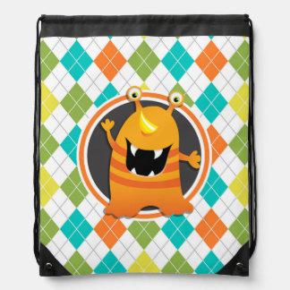 Orange Monster on Colorful Argyle Pattern Backpack