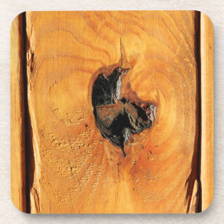 Orange natural wood with black hole and spiderweb beverage coaster