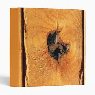 Orange natural wood with black hole and spiderweb binder
