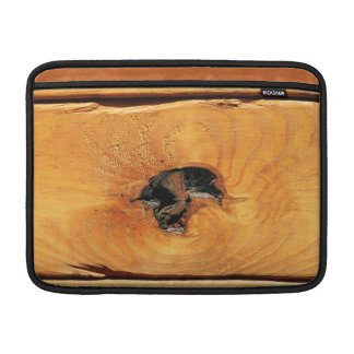 Orange natural wood with black hole and spiderweb sleeves for MacBook air