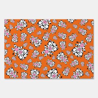 Orange nerd cow pattern lawn sign