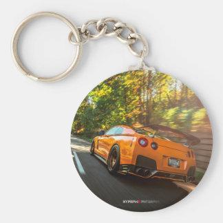 Orange Nissan GT-R Ripping through Seattle streets Basic Round Button Keychain
