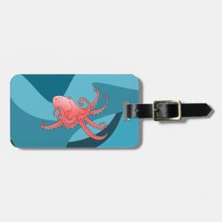 Orange octopus in swirling sea bag tag