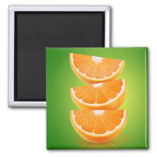 Orange pieces on green magnet