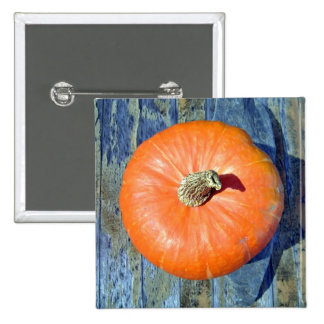 Orange Pumpkin on table - top view Pinback Buttons
