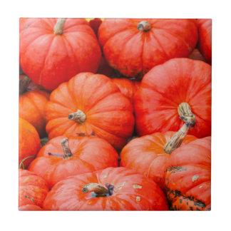 Orange pumpkins at market, Germany Ceramic Tile