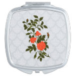 Orange Roses on Light Blue Lacy Background Vanity Mirror