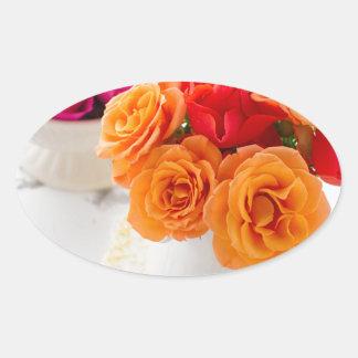 orange roses oval sticker