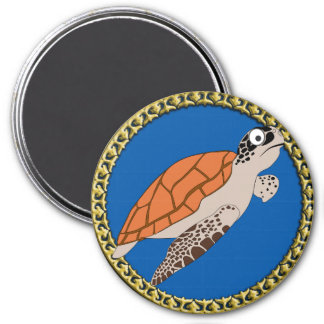 Orange sea turtle swimming with a gold frame magnet