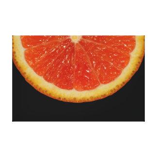 Orange slice on black canvas print