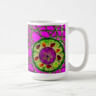 Orange slice with stones on mesh background coffee mug