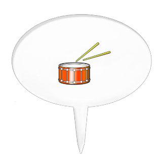 orange snare graphic with sticks cake topper
