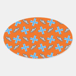 Orange snowboard pattern oval sticker
