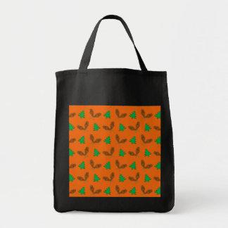 Orange snowshoe pattern tote bags
