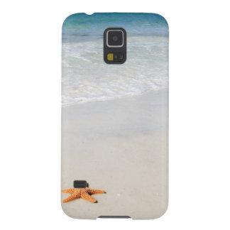 Orange starfish on a white sandy beach cases for galaxy s5