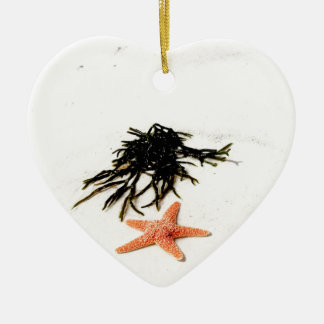 Orange starfish on a white sandy beach ceramic ornament