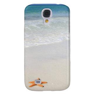 Orange starfish on a white sandy beach galaxy s4 cover