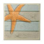 "Orange Starfish Tile<br><div class=""desc"">An orange starfish on a pastel distressed background.</div>"
