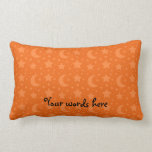 Orange stars and moons pattern pillow