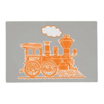 Orange steam train on gray laminated placemat