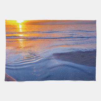 Orange sunset at sea hand towel