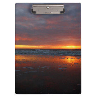 Orange sunset beach island of Texel Netherlands Clipboards
