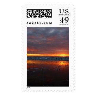 Orange sunset beach island of Texel Netherlands Stamps