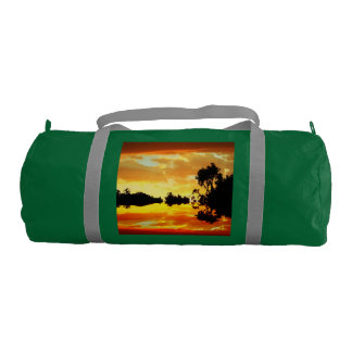 Orange Sunset Reflected in Lake Trees Silhouetted Duffle Bag
