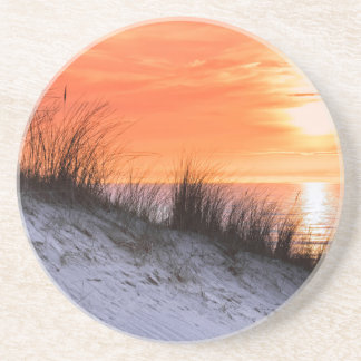 Orange sunset with dune and sea coaster