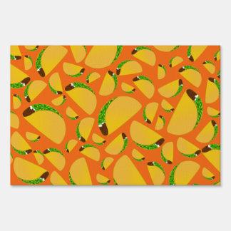 Orange tacos yard signs