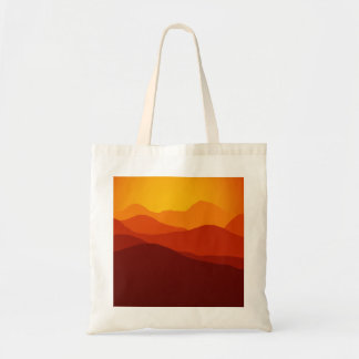 Orange Tones Sunset over Mountain Silhouettes Tote Bag