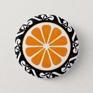 orange. tribal. pinback button