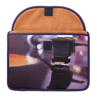 Orange Vinyl Record with cool purple background Sleeves For MacBook Pro
