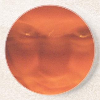 Orange weird face, eyes looking up coaster