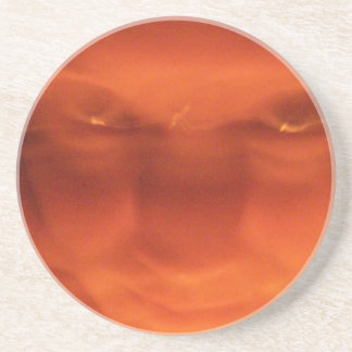 Orange weird face, eyes looking up drink coaster