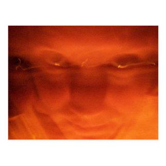 Orange weird face, eyes looking up postcard