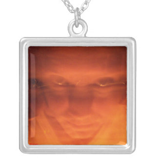 Orange weird face, eyes looking up silver plated necklace