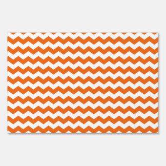 orange  white chevrons sign