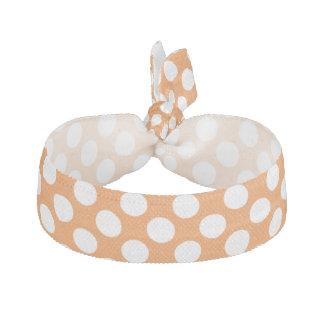 Orange with white polka dots hair tie