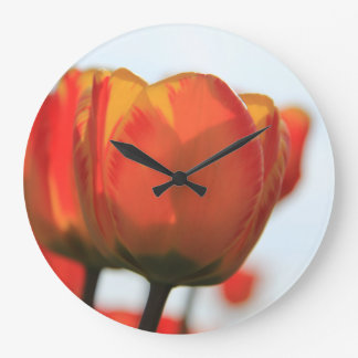 Orange yellow tulips by Thespringgarden Large Clock