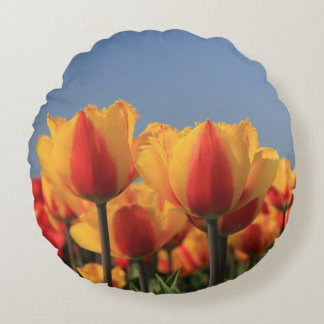Orange yellow tulips by Thespringgarden Round Pillow