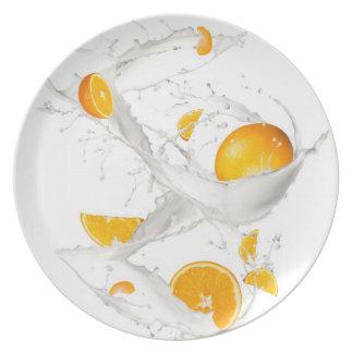 Oranges in milk splash plates