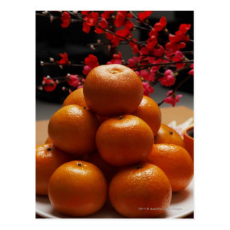 Oranges stacked on plate post card