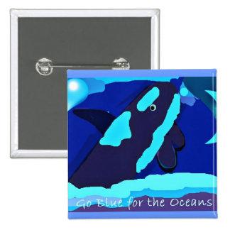 orca azul para el botón de los océanos pin