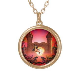 Orca in the sunset round pendant necklace