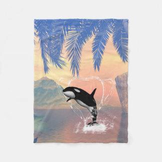 Orca jumping through a heart fleece blanket