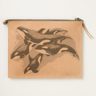 orcas in blue travel pouch