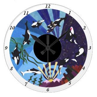 Orcas que ascienden - con números reloj redondo grande