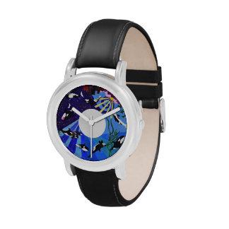 Orcas que ascienden relojes