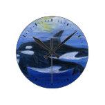 Orcas que nadan el reloj de pared 1